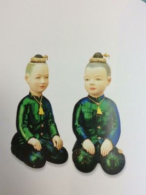 thai dolls carved from ivory wood with beetle wing decoration