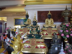 inside the Golden Mount, Buddha statues wearing different attires for the three seasons (summer, raining season and winter) in Thailand