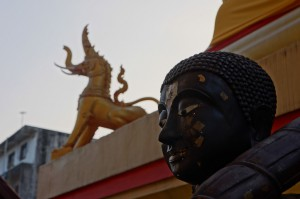 Khochasi next to Buddha statue (photo credit: jeffenjane.com)