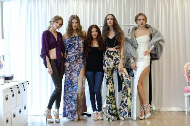 'Pam' Anisha Attaskulchai, third left, designer of Lovebird & her models