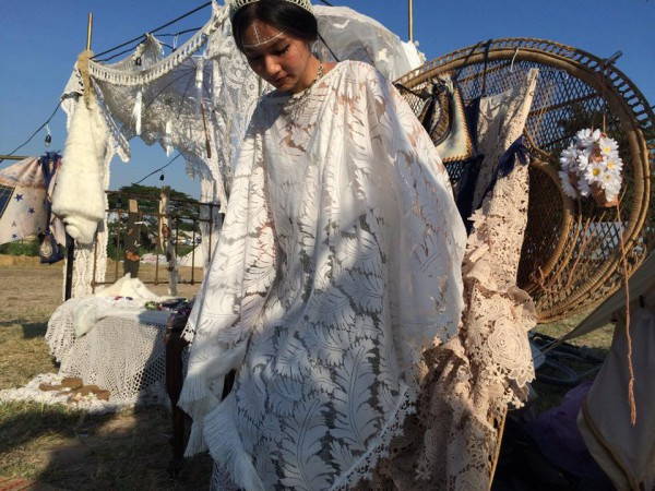 Rotsaniyom designer 'Gift' wearing an extravagant lace dress