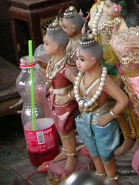 Kuman Thong figures at a shrine in Ratchaburi Province (photo Xufanc wikimedia.org)