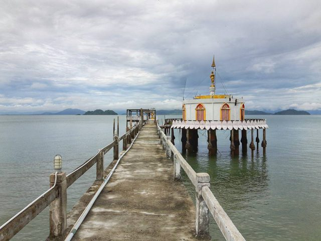 A floating pagoda at a pier in Koh Phayam*