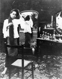 Dara Rasami in front of her dresser, unwinding her hair. All images courtesy of the National Archive of Thailand*