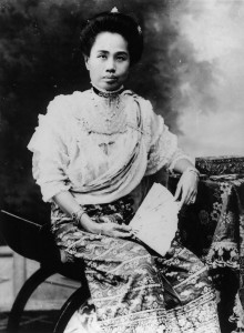 Recently promoted to the rank of High Queen, Dara Rasami poses for a formal portrait in her hometown, Chiang Mai. Note that she wears a phasin [skirt] made from a Burmese court textile calle*