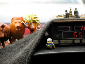 A typical yet unusual combination of talismans and mascots in a Bangkok taxi*