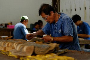 A woodcarver at work in Mueng Boran**