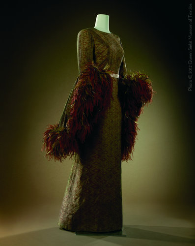 Gown designed by Pierre Balmain for Queen Sirikit for a trip to Japan in 1981.It is made of silk ikat, also called mat mii, from northeastern Thailand and trimmed with dyed ostrich feathers. (photo credit: Queen Sirikit Museum of Textiles)