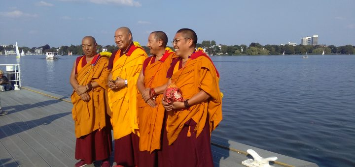 Four Tibetan monks from Sera Je at the Alster in Hamburg